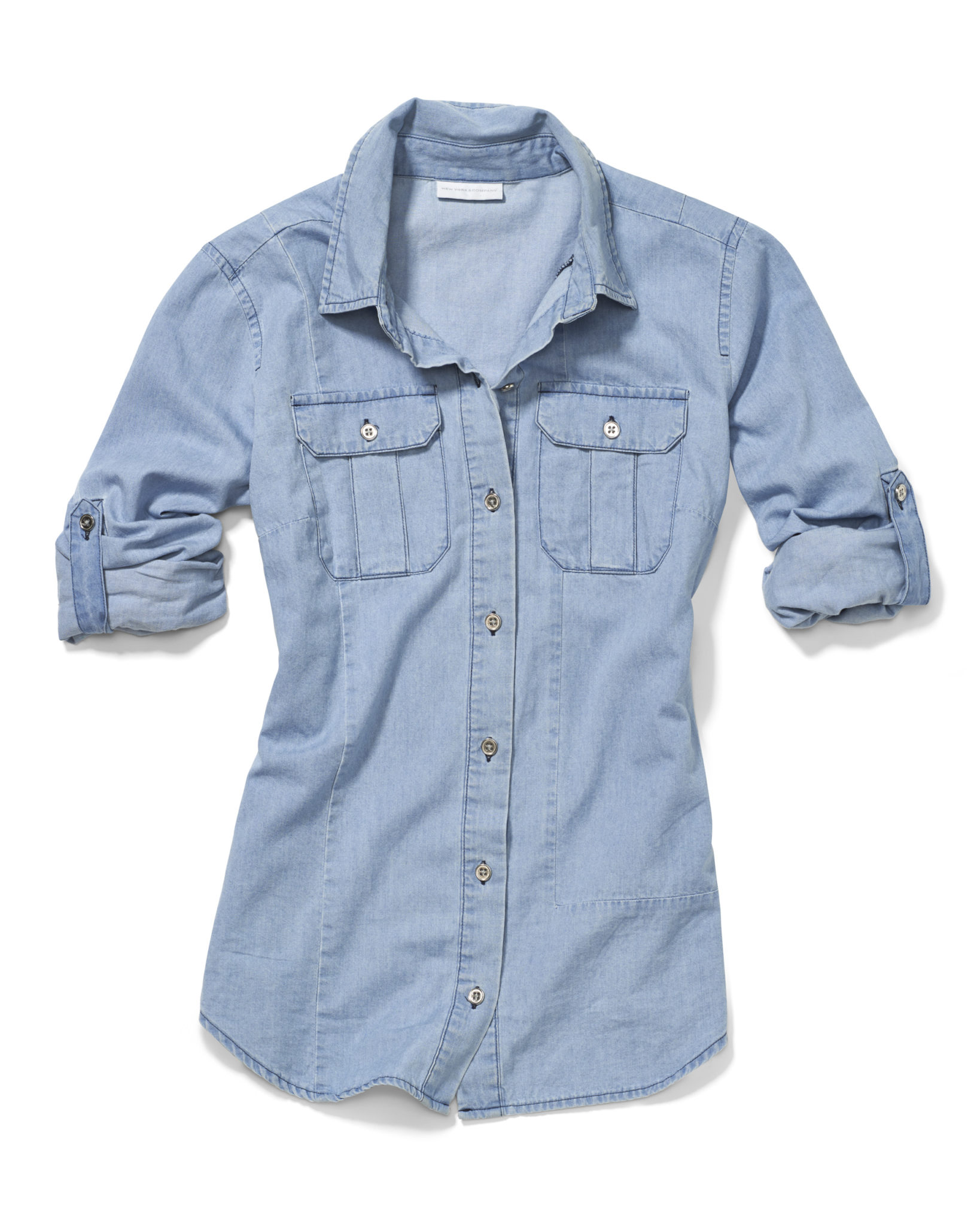 a product photograph of a denim shirt with soft styling on white