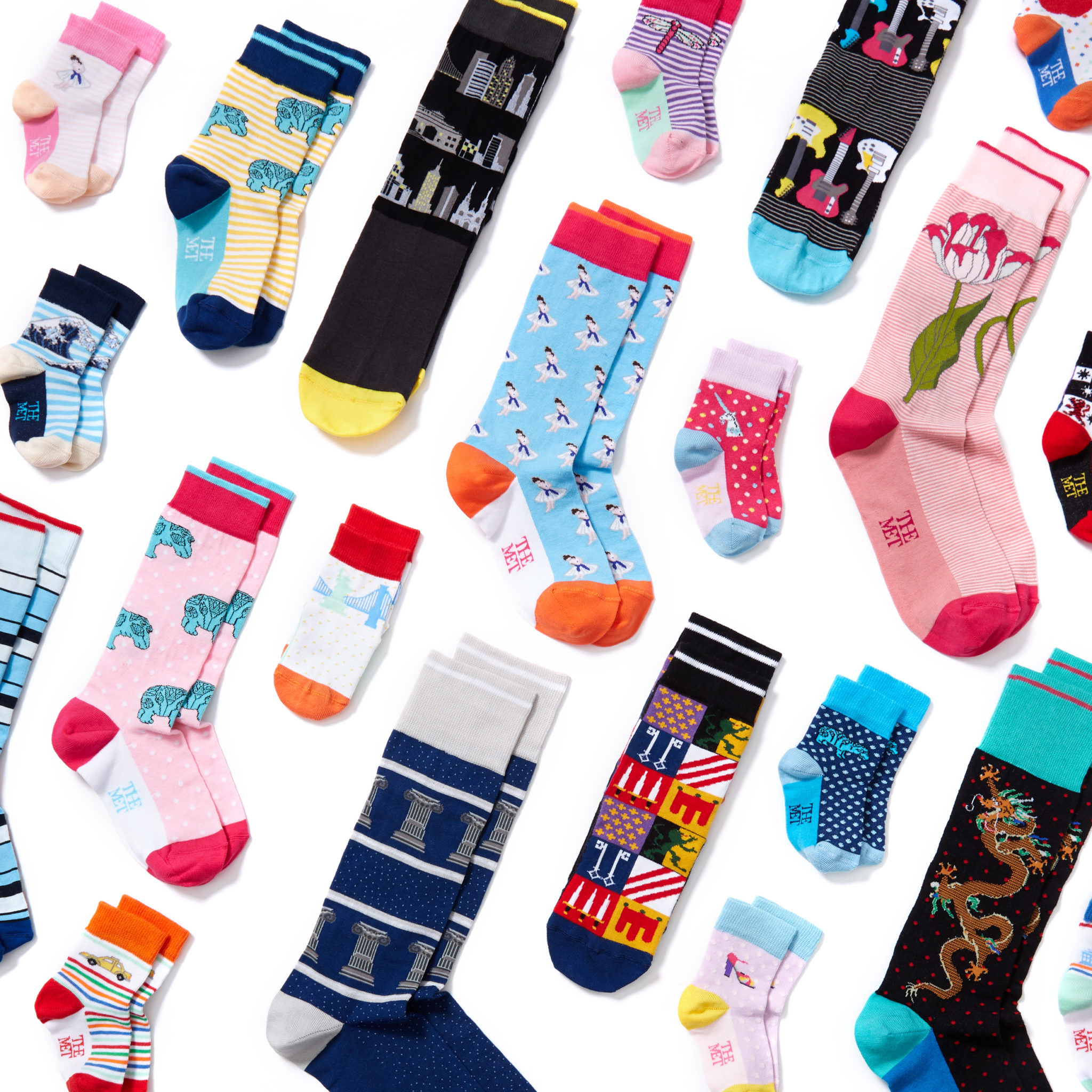 a marketing photograph of many socks styled in an angled grid on white