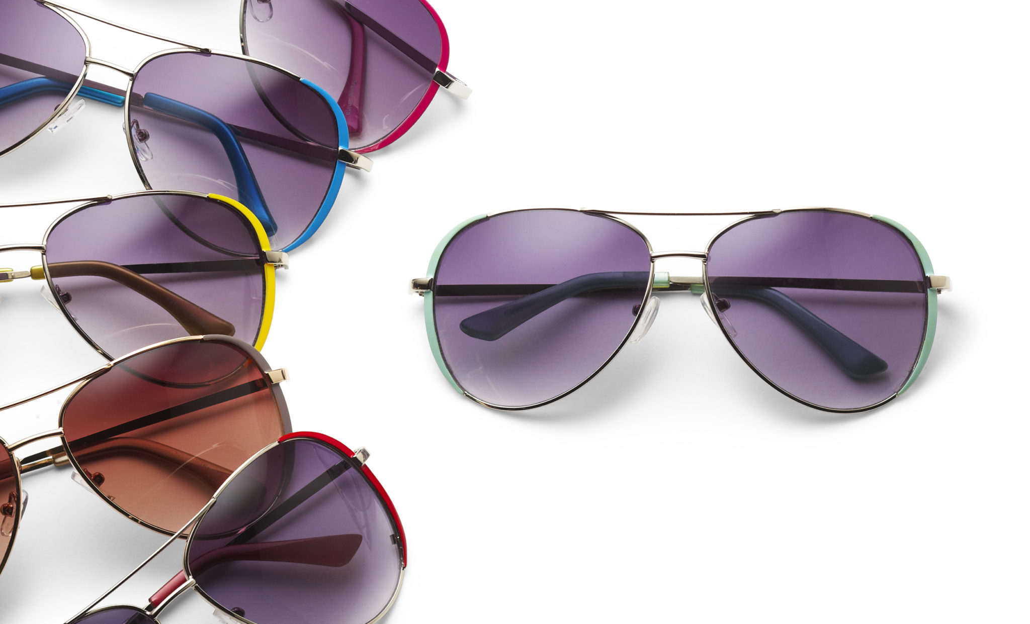 e-commerce group photograph of sunglasses with colorful frames.  five are fanned and one more by itself