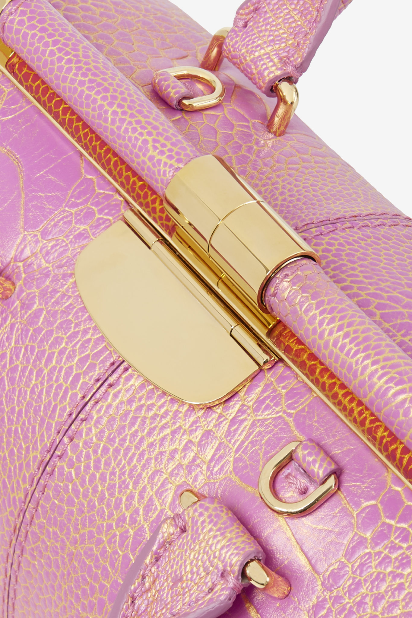 e-commerce product detail of pink and gold ostrich leg doctor bag